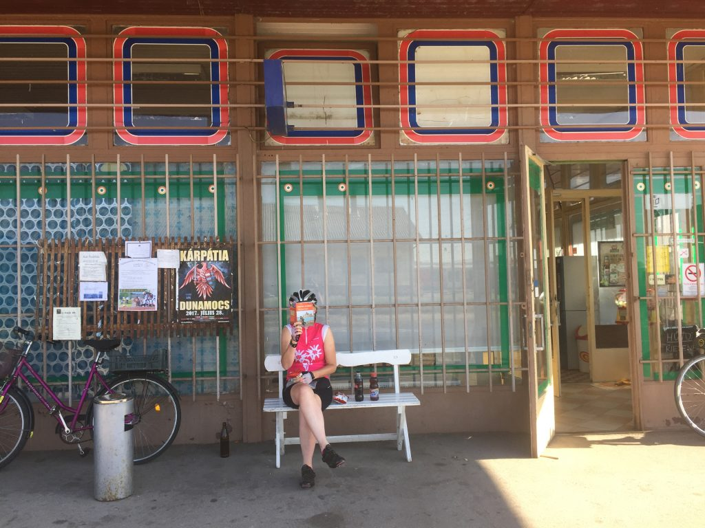 Wendy Burger enjoying a break outside a typical grocery store on the Danube cycle path