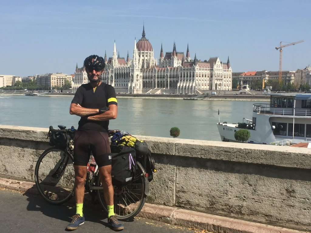 Paul webb opposite the Parliament in Budapest cycle Danube Eurovelo6